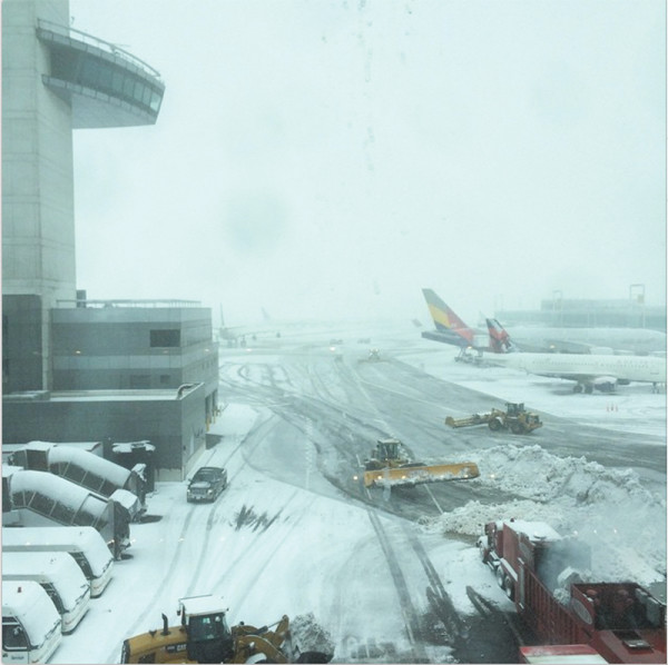 JFK airport in full snow! So happy that our flight to LA didn't get cancelled today! wish us a good flight! #macaronsfashionroadtrip